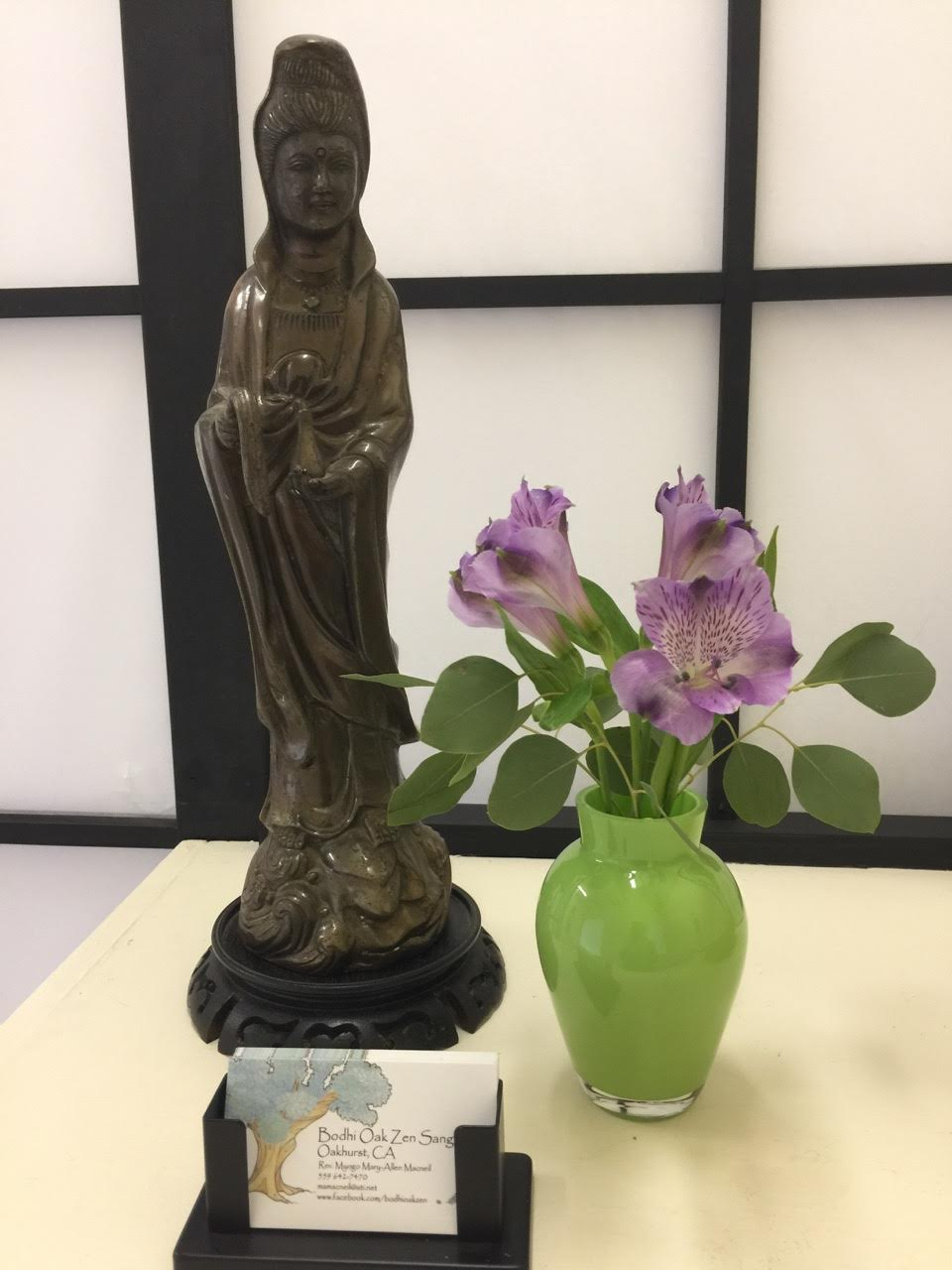 Business card and Buddhist statue